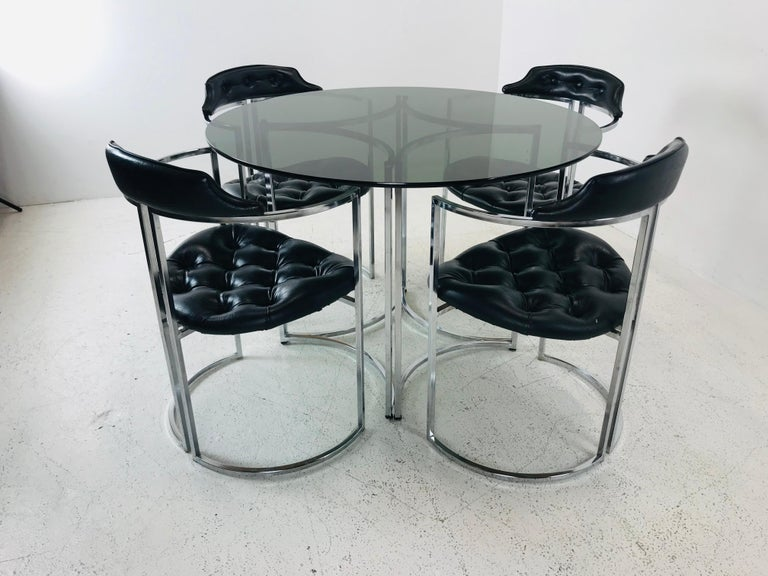 Four Daystrom chairs with smoked glass table top with chrome base. Table is 42 D x 29 H Chairs are 22 W x 27 D x 37 H SH 20
