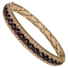 Dazzling 15.15 Carat Blue Sapphires and Diamonds 18 Karat Hinged Bangle Bracelet