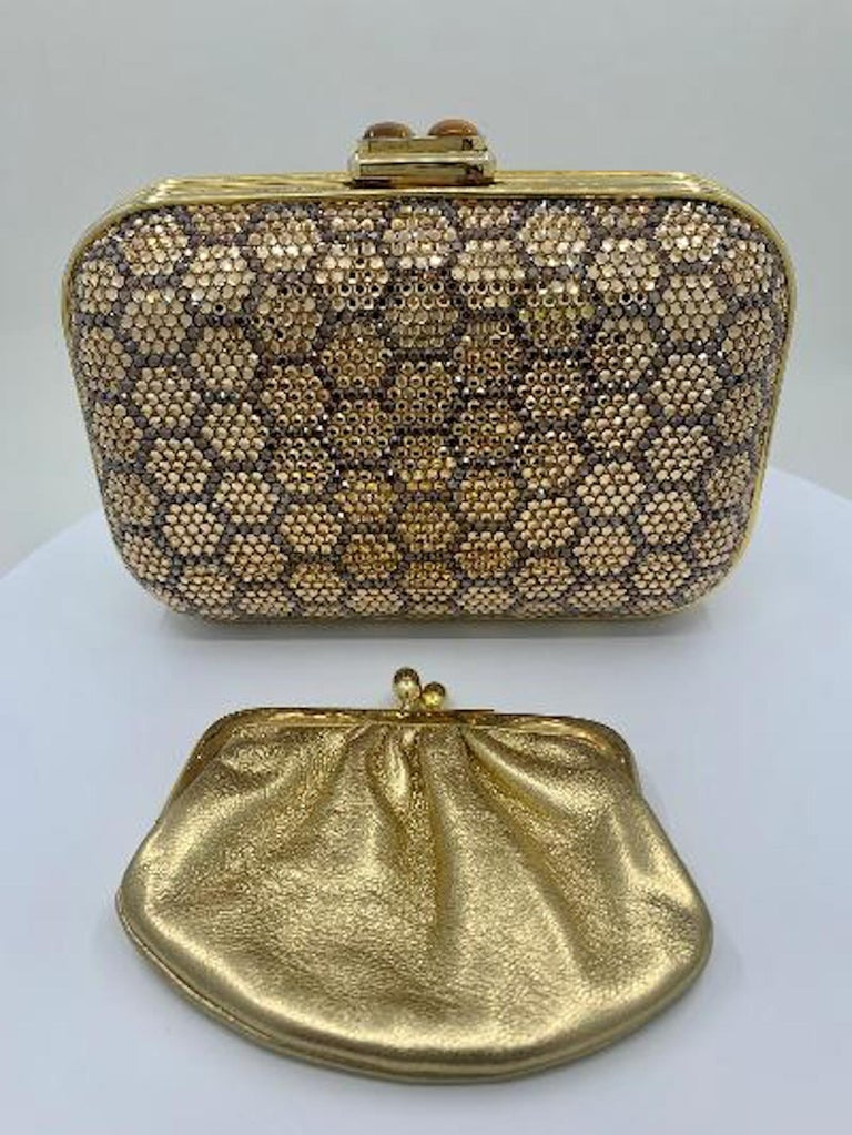 Meet a clutch with real icon status! This timeless and elegant hand made couture designer Judith Leiber rectangular shaped honeycomb pattern minaudiere evening bag or clutch has rounded corners and a gold toned metal frame covered in dazzling silver