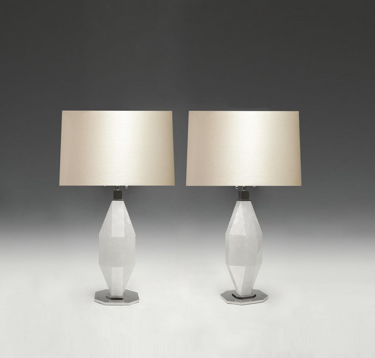 Pair of diamond rock crystal lamps with nickel plating bases. Created by Phoenix Gallery, NYC.  Each lamp installs two sockets. Lampshade do not include. To the top of the rock crystal 18 in / H.