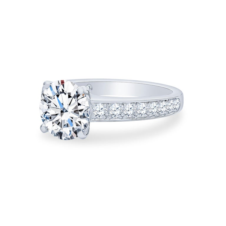 De Beers platinum engagement ring set with one 2.40 carat round brilliant cut center diamond, D color, SI1 clarity and 0.50 carats total weight in accent diamonds.  Size 5.75 and may be resized larger or smaller upon request. The center diamond is a