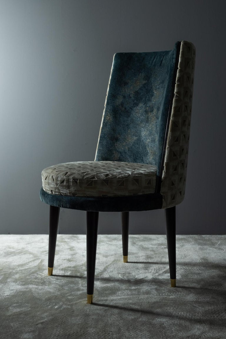 Wooden chair upholstered in blue-green and a beige jacquard-patterned velvet. Semicircular backrest with an inset fillet of beech veneer, dark brown stained with satin finish. Legs in solid beech dark brown stained with satin finish, and end caps in