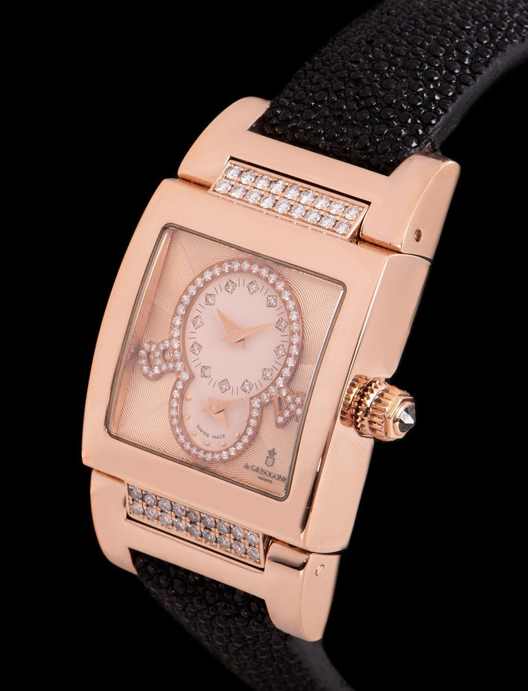 An 18k Rose Gold Instrumentino Dual Time Ladies Wristwatch, salmon pink guilloché dial set with 12 applied round brilliant cut diamond hour markers, second time zone at 6 0'clock, a ring set with 50 round brilliant cut diamonds and applied diamond
