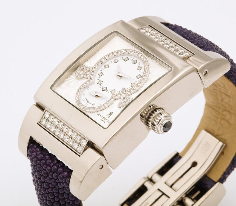 De Grisogono Instrumentino Model: TINO S02 AT Case: Polished white gold set with white diamonds; front & back case anti-reflection sapphire glass  Dial:  White guilloché enamel, set with diamonds Bracelet: Purple galuchat strap with polished white