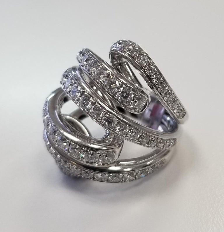 A fabulous rolling ring design diamond cocktail ring by De Grisogono from the Vortice collection set with 5.40cts of the finest round brilliant cut diamonds in 18k white gold. No. B 86529