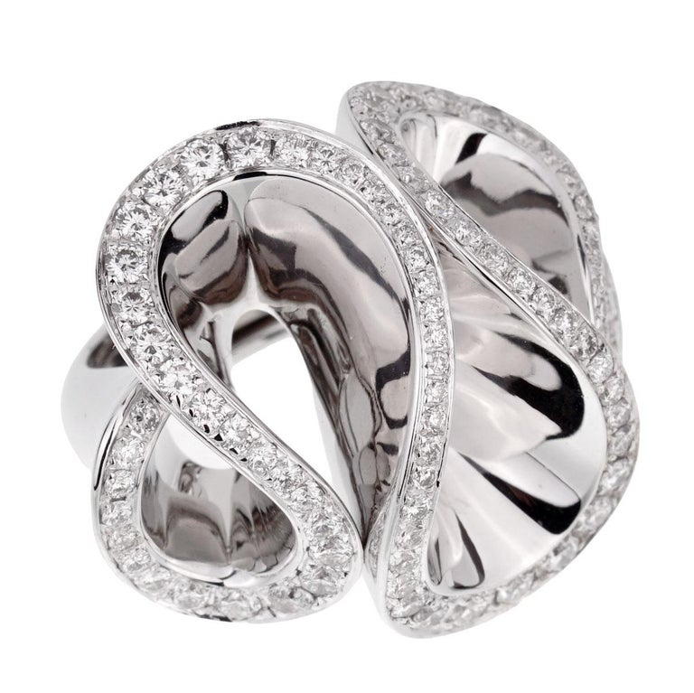 A magnificent De Grisogono diamond cocktail ring in shimmering 18k white gold adorned with the finest round brilliant cut diamonds.  The ring retails for appx $20,000