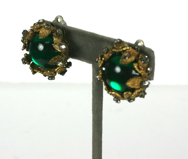 De Mario Green Cabochon and Crystal Earrings from the 1950's. A green glass cabochon is held in place by gilt leaves decorated with crystals.  1