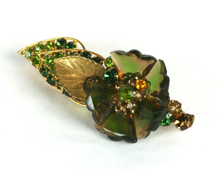 De Mario Faceted Glass Petal Flower Brooch from the 1940's. Unusual changeant green-topaz faceted Czech petals form the flower head accented by an array of green and topaz crystals all hand sewn onto a filigree base. 1940's USA.  3