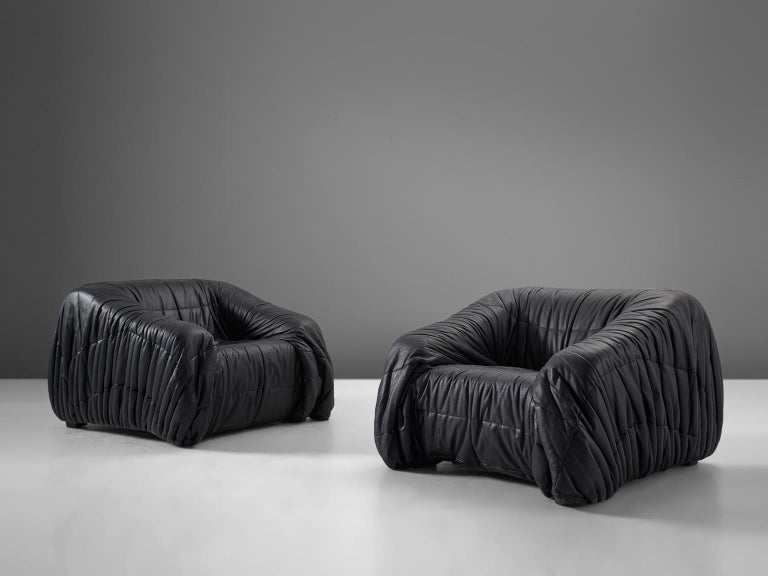 Jonathan de Pas, Donato D'urbino & Paolo Lomazzi for Dell'Oca,'Piumino' lounge chairs, leatherette, Italy, 1970s  These lounge chairs are completely moulded out of foam and covered with folded black, thick but soft leatherette. One of the main
