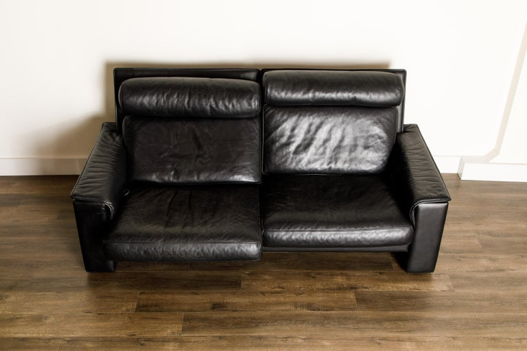 De Sede Aged Black Leather Recliner Loveseat Sofa, 1970s Switzerland, Signed In Good Condition For Sale In Los Angeles, CA