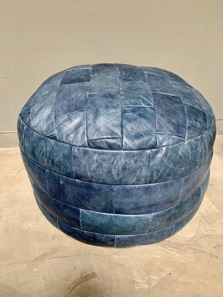 Unique patchwork leather ottoman by De Sede with blue colored leather strips. Great coloring and patina to leather. Very good condition. Great accent piece.