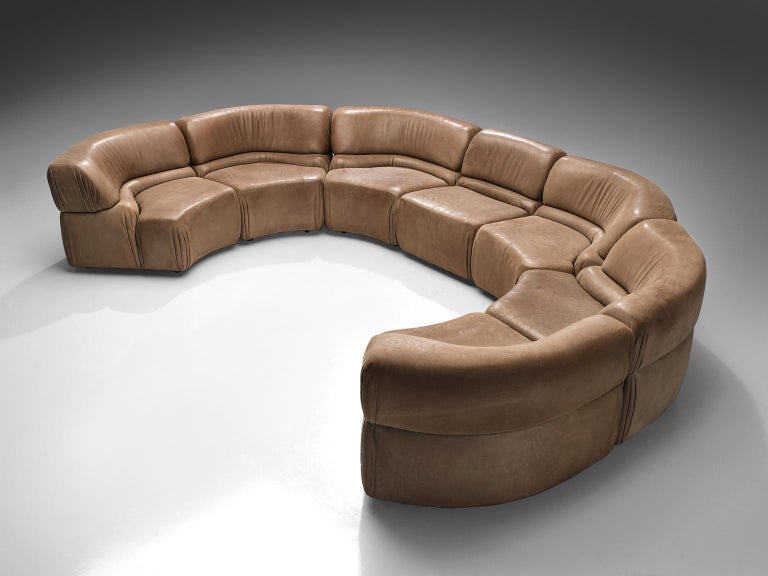 De Sede, 'Cosmos', patinated brown leather, seven elements, Switzerland, 1970s.  Thick, high-quality modular sofa made by De Sede in Switzerland in the 1970s. Due to the separate elements, the couch can be used in a variety of different positions.