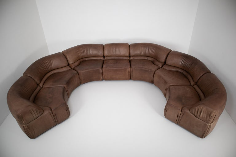 Comfortable so called 'Cosmos' elemented sofa designed and manufactured by De Sede, Switzerland, 1970. This sofa has a wooden structure stuffed with foam and covered with buffalo leather. The sofa is in patinated brown leather and is in good