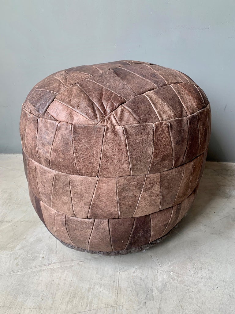 Unique patchwork leather ottoman by De Sede with multicolored brown leather strips. Great coloring and patina to leather. Very good condition. Great accent piece.