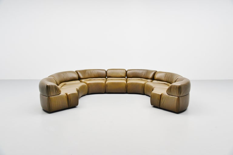 Spectacular an very comfortable so called 'Cosmos' elemented sofa designed and manufactured by De Sede, Switzerland, 1970. This sofa has a wooden structure filled with foam and covered with olivegreen buffalo leather. The sofa is in very nice olive