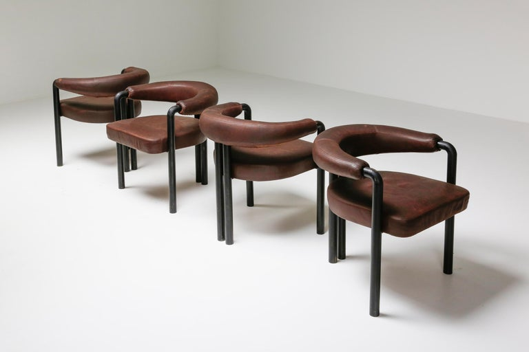 Mid-Century Modern armchairs, De Sede, Switzerland, 1960s, brown leather, black steel  Modernist inspired armchairs, simple in design and outstanding in comfort. Similar to this chair are the Italian designed chairs 'Pigreco' by Scarpa and