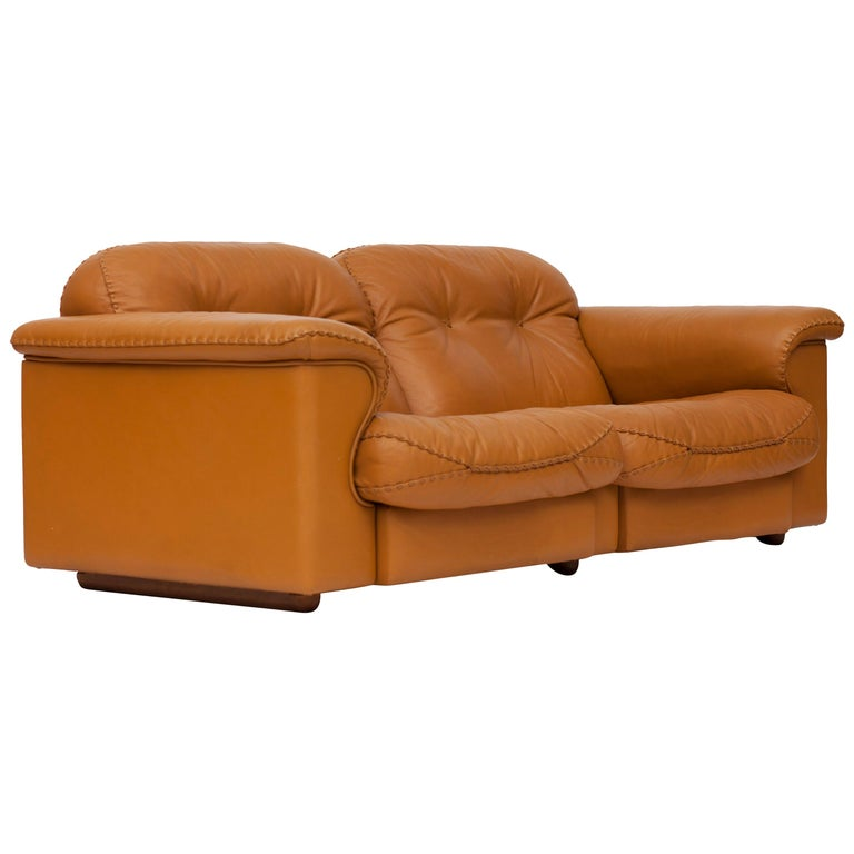 Mid-Century Modern adjustable and comfortable two-seat sofa by De Sede. The sofa is provide with a high quality brown leather and interesting think stitched seams. The sofa features in a James Bond movie.