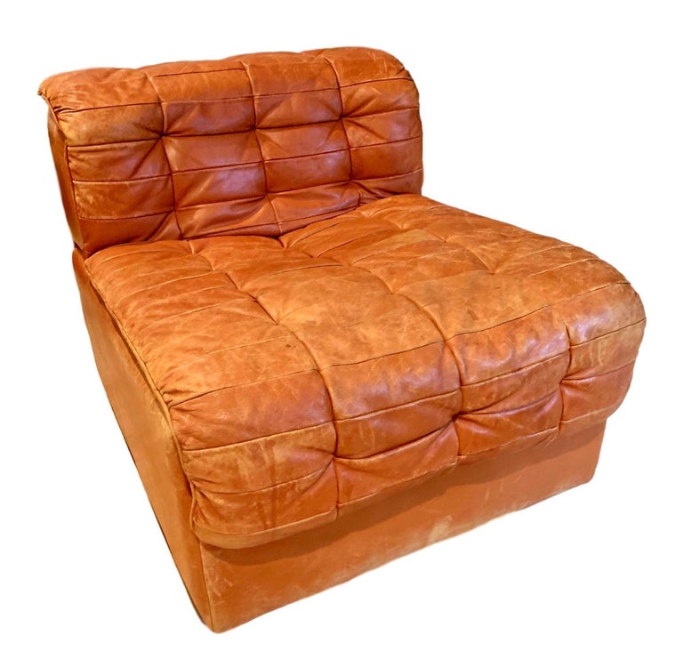Classic modular leather sofa by De Sede, Model DS-11. Great coloring and patina to patchwork saddle leather. Each chair can Stand alone by itself. Can be arranged in a multitude of ways. Original De Sede labels. Six pieces total. Sold as set of six.