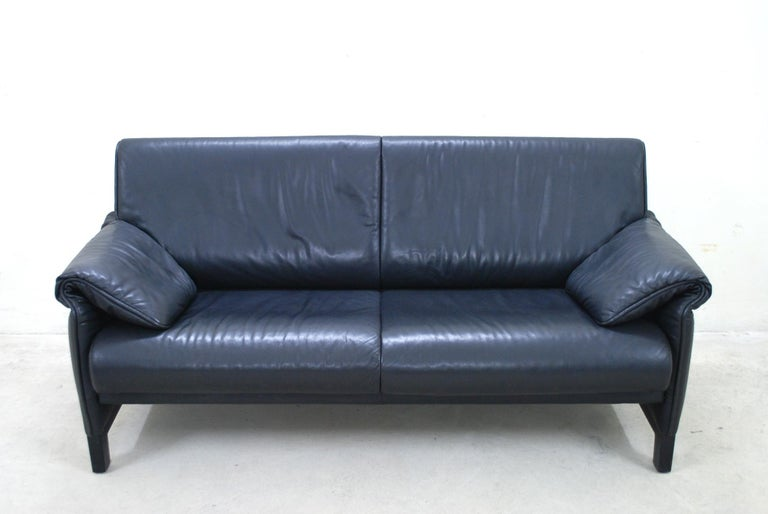 De Sede model DS 14 leather sofa. Black aniline leather. The legs were made of black lacquered wood.  We also had an armchair that fits well to this sofa.