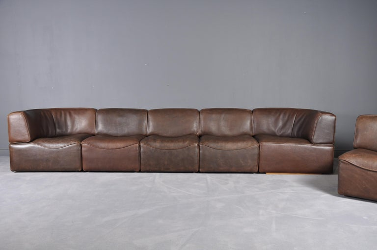 Sectional sofa model DS-15, in leather by De Sede, Switzerland, 1970s. This sectional sofa contains two corner elements, four normal elements. The section make it possible to arrange this sofa to your own wishes. The design is simplistic yet