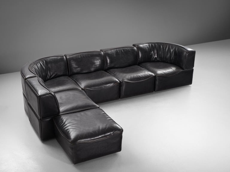 Sectional sofa model DS-15, black leather by De Sede, Switzerland, 1970s.   This high quality sectional sofa contains two corner elements, three normal elements and one ottoman, which makes it possible to arrange this sofa to your own wishes. The