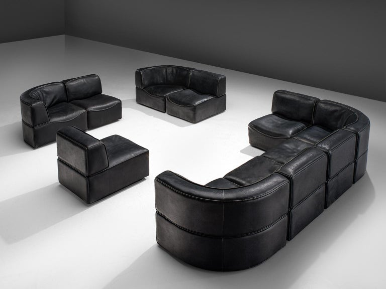Sectional sofa model DS-15, black leather by De Sede, Switzerland, 1970s.   This high quality sectional sofa contains four corner elements and six normal elements, which makes it possible to arrange this sofa to your own wishes. The design is