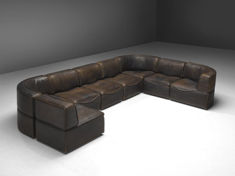 De Sede', DS15 sofa, patinated brown leather, eight elements, Switzerland, 1970s.  Thick, high-quality modular sofa made by De Sede in Switzerland in the 1970s. Due to the separate elements, the couch can be used in a variety of different
