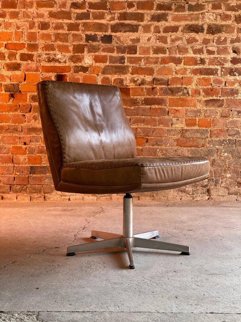 De Sede DS 35 Executive swivel desk chair, Switzerland circa 1960  Magnificent midcentury De Sede DS 35 executive office swivel desk chair Switzerland circa 1960, upholstered in the finest tan leather with broad stitch edge detail, raised on