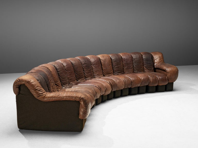 De Sede 'Snake' DS-600, brown leather, Switzerland, 1972.  A design by Ueli bergere, Elenora Peduzzi-Riva, Heinz Ulrich and Klaus Vogt at De Sede, Switzerland. De Sede 'Non Stop' sectional sofa containing of fourteen seating pieces and two armrests