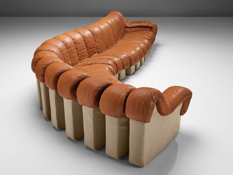 De Sede 'Snake' DS-600, cognac leather, fabric, Switzerland, 1972  A design by Ueli bergere, Elenora Peduzzi-Riva, Heinz Ulrich and Klaus Vogt at De Sede, Switzerland. De Sede 'Non Stop' sectional sofa containing of eighteen seating pieces and two