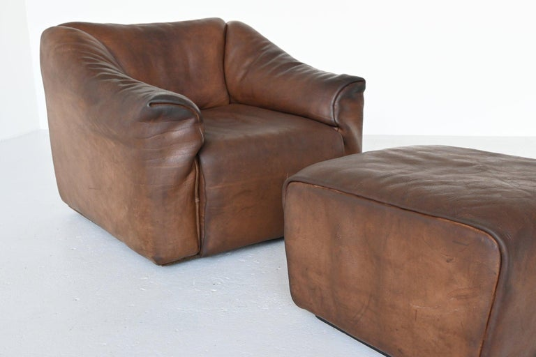 Very comfortable DS47 armchair with ottoman designed and manufactured by De Sede, Switzerland, 1970. This set is made of high quality brown buffalo leather. De Sede is known for its supreme quality leather and comfort seating. The armchair has the