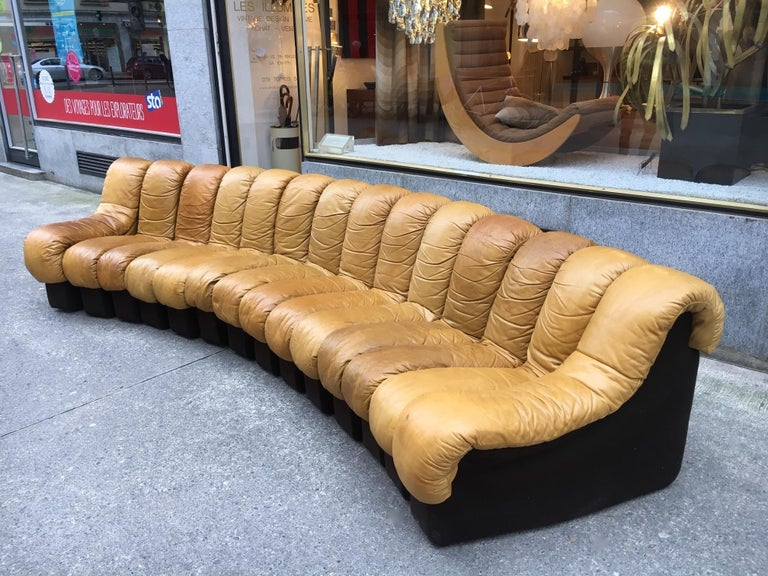 DS600 patinated cognac leather sofa, 14 sections (350cm) Ueli Berger, Klaus Vogt, Eleanore Peduzzi-Riva and Heinz Ulrich produced by De Sede, Switzerland, circa 1970 Each sections is zipped to the other, the sofa is articulated, you can choose the