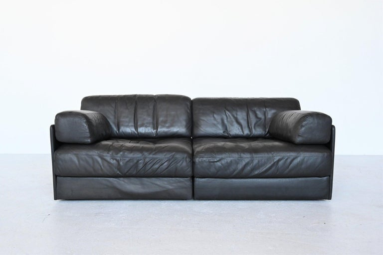 Very comfortable and multi-functional DS76 two-seat sofa designed and manufactured by De Sede, Switzerland 1970. This sofa is made of high quality black leather and finished by hand with high levels of craftsmanship and eye for detail. De Sede is