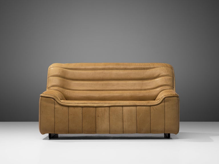 De Sede, 'DS84' sofa, leather, Switzerland, 1970s  Highly comfortable DS84 sofa in light beige buffalo leather by De Sede. The design is simplistic, yet very modern. This model features a solid base with a bulky seat and a high back. The armrests