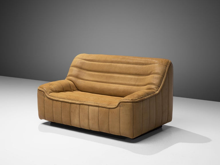 De Sede, 'DS84' sofa, leather, Switzerland, 1970s  Highly comfortable 'DS84' sofa in light beige buffalo leather by De Sede. This model features a solid base with a bulky seat and a high back. The armrests flow over to the seat. The leather is