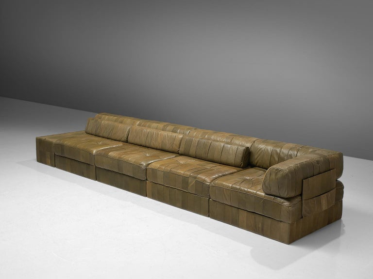 De Sede, sofa, DS 88, olive green patinated leather, 1970s.   This comfortable leather sofa is made by quality manufacturer De Sede in Switzerland. Known for its craftsmanship, highest quality leather, and unique aesthetics, De Sede manufactures