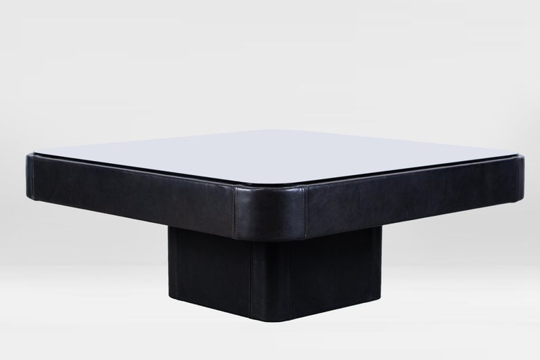 De Sede coffee table, Switzerland, 1970s, completely covered in dark brown leather and smoked glass top.