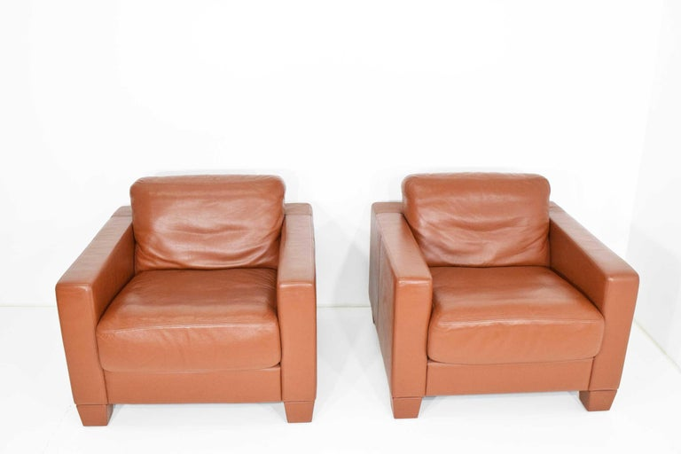 Model DS-17 in saddle/cognac leather. Beautiful condition. We have four and are offering in pairs. We also have the sofa that matches this set under a separate listing. Legs can be replaced with wood if desired. They screw on.
