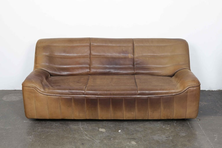 Brown leather three-seat sofa made by De Sede, Switzerland, model DS 84, with original buffalo leather that has vintage wear and patina as seen in the photos.
