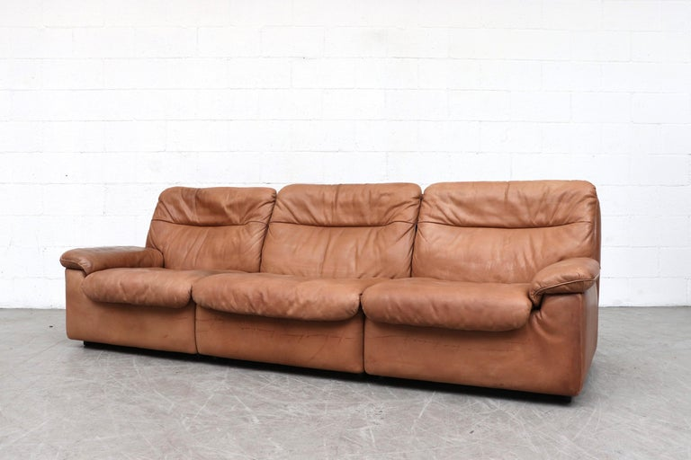 Handsome De Sede DS 66 natural leather 3-Seat Sofa. Thick light brown leather with nice patina. In original condition with some signs of wear consistent with age and use. Matching loveseat (LU922413830531) and lounge chair available