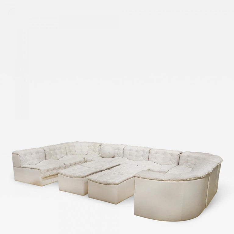 A Swiss modular sofa made by De Sede and distributed by Stendig model no. DS-11. The extensive sectional seating system is consists of 14 pieces that include 6 armless seats (21