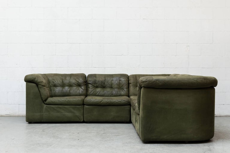 Gorgeous midcentury green patchwork leather four-piece sectional sofa with matching lounge chair. Good original condition with signs of wear consistent with its age and usage.