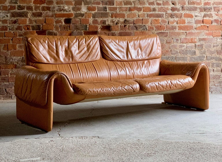De Sede, Switzerland Cognac leather sofa design no DS2011, circa 1980.  De Sede Switzerland Cognac Leather two-seat sofa model DS-2011 circa 1980, This fabulous one owner sofa has a wonderful aged look giving it real character and style, its