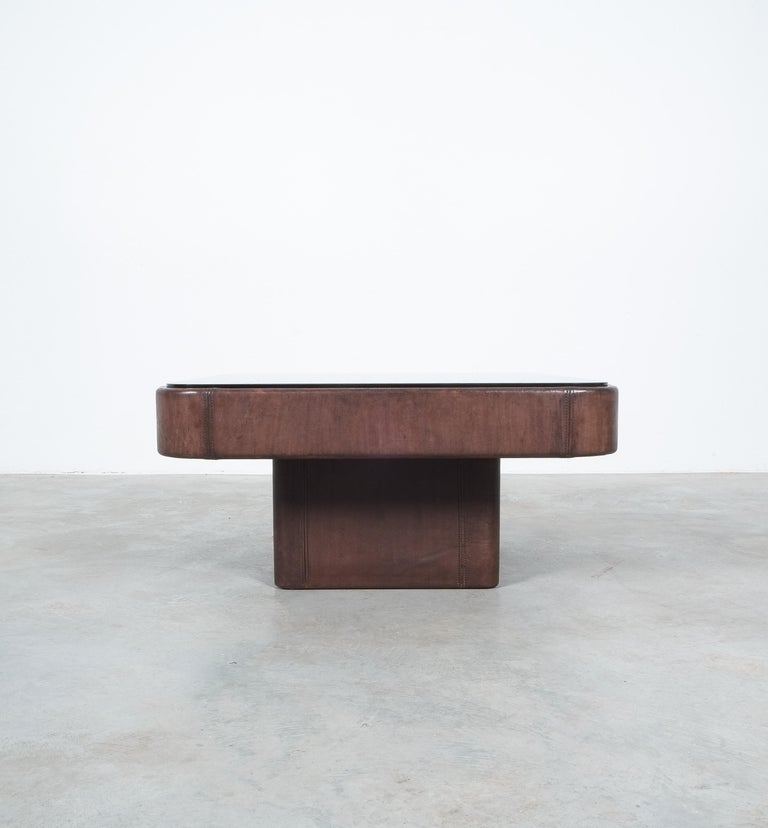 """De Sede leather table with bronze mirror glass top in best condition, Switzerland 1970  Beautiful table, well sized with 31"""" and fully wrapped in the trademark thick bull leather of the Ds-47 series.  The leather is rustique brown with a nice"""