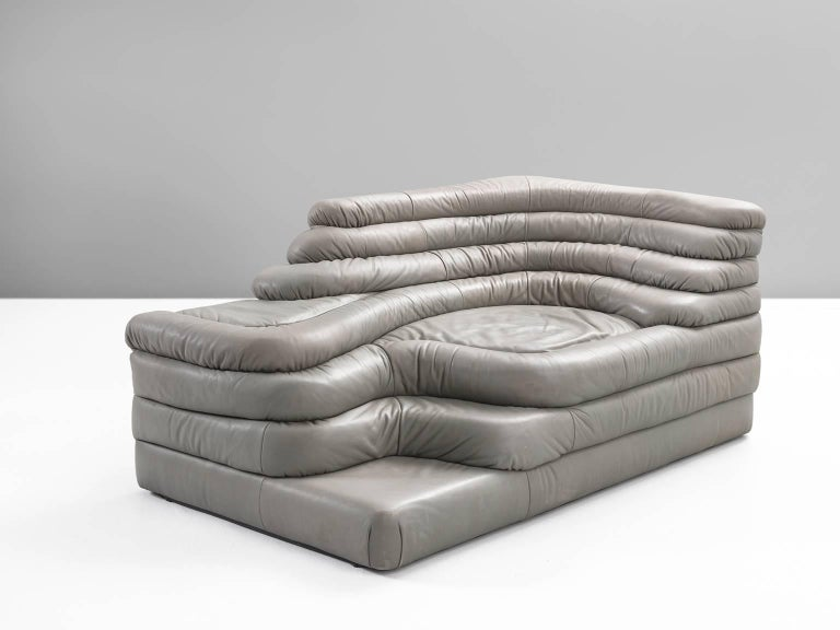DS1025 'Terrazza' landscape element, in grey leather by Ubald Klug for De Sede, Switzerland, 1970s.   Wonderful leather waterfall shaped sofa in grey leather by the Swiss manufacturer De Sede. This company is known for its outstanding high-quality