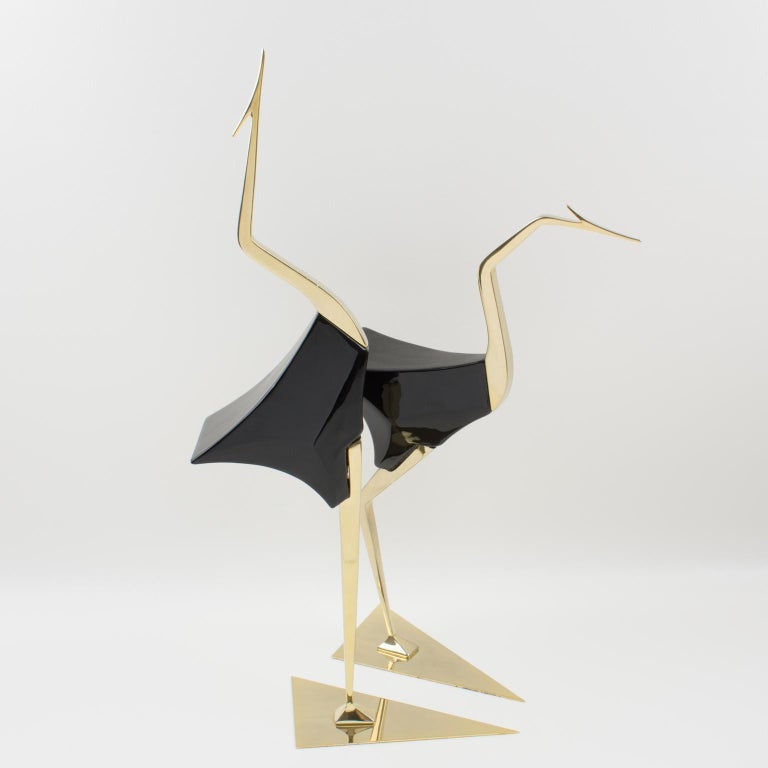 A stunning pair of large birds, egret or wader, designed and handcrafted by Italian company De Stijl in Firenze. Each bird is carefully crafted with shiny gilded brass and glossy polished black lacquered carved wood. They have an unusual post-cubist