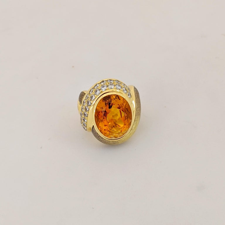 Started in 1967 by Leo and Ginnie de Vroomen the company is known for bold and innovative designs. Distinctive from the start, the renowned company is simply known as de Vroomen. This  18 karat yellow gold ring is designed using guicholle enamel in