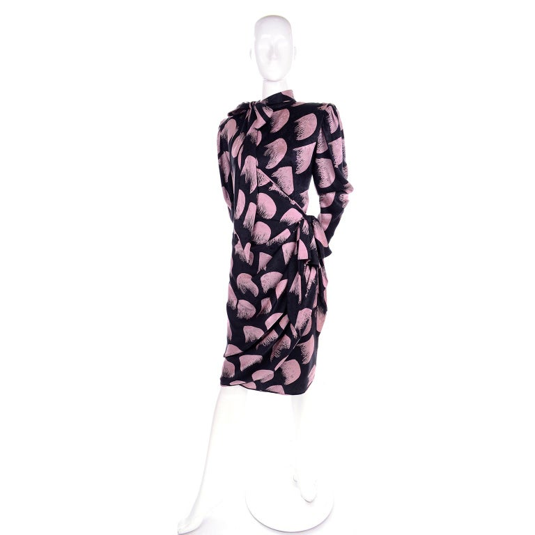 This is a lovely vintage dress from Emanuel Ungaro from the 1980's that is unworn with its original tag still attached.  This beautiful Ungaro Parallele wrap style dress was made in Italy and is beautifully draped and has shoulder pads, an attached