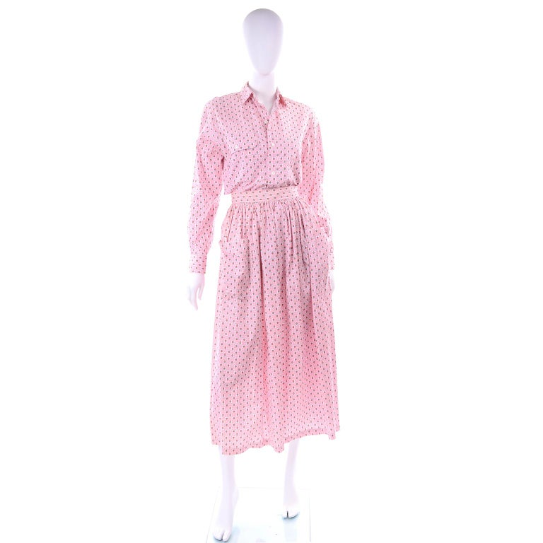 This is a pretty vintage 2 piece dress outfit from Ralph Lauren in a pink floral cotton print.  The outfit is new with original tags attached and includes a button front blouse and a skirt with 2 front pockets. The skirt closes with a zipper and