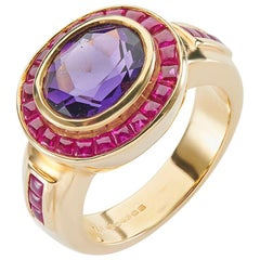 Deakin & Francis 18 Carat Yellow Gold Amethyst Ring with Ruby Border